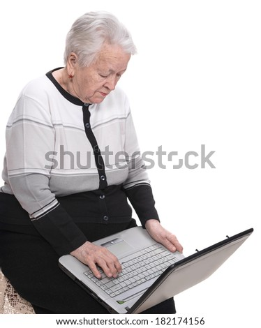 Old woman working on computer on a white background