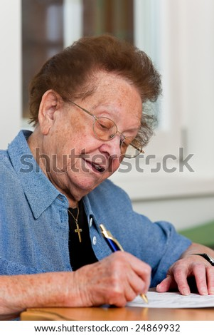Old woman writes a letter