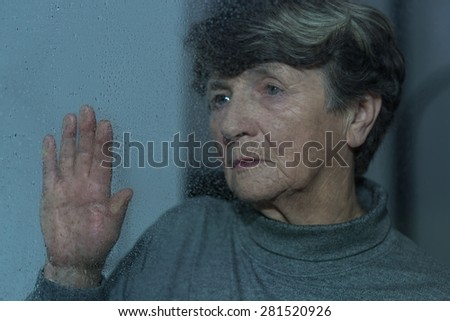 Old women feels lonely, unhappy and depressed - stock photo