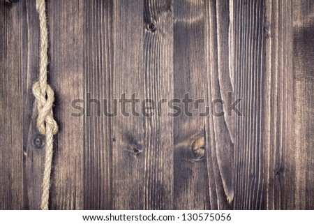 Old wood background with rope - stock photo