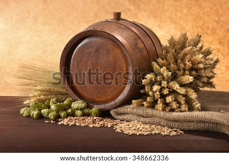 old wood barrel with hops, wheat, grain, barley and malt