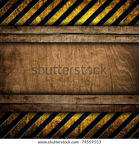 old wood board with warning stripe pattern