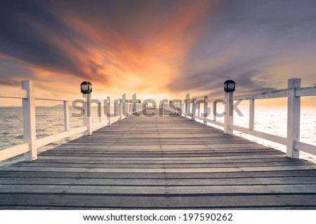 old wood bridge pier with nobody against beautiful dusky sky use for natural background ,backdrop and multipurpose sea scene - stock photo