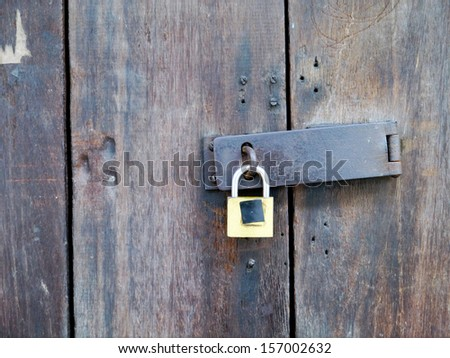 Old wood door with key art background.