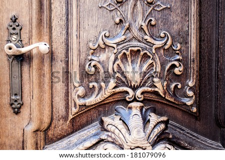 Old wood door with metal handle - stock photo