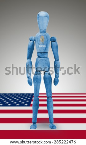Old wood figure mannequin with US state flag bodypaint - Oklahoma - stock photo
