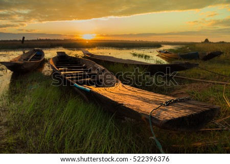 Old wood Fishing boat and lighting after sunset.