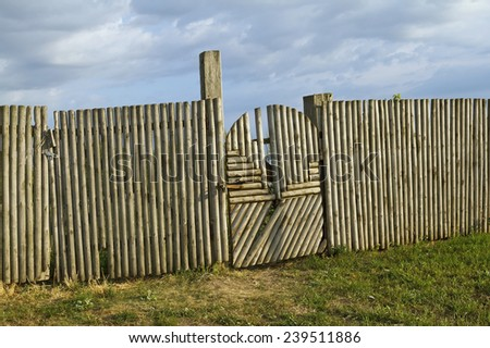 Old wood picket fence and gate with latch  - stock photo