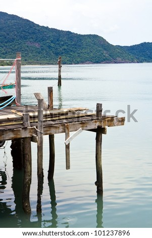 Old wood pier in the sea Thailand - stock photo