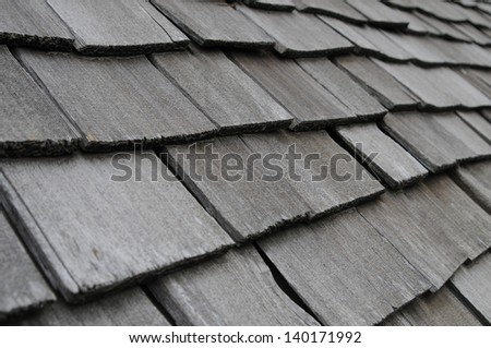 Old wood shake roof. - stock photo