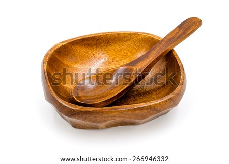 Old wood spoon and wood bowl in isolated background. - stock photo