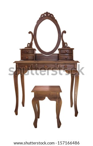 Old wood vanity table and chair for a woman in the house - stock photo