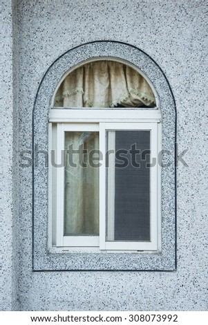 Old wood window on concrete wall - stock photo