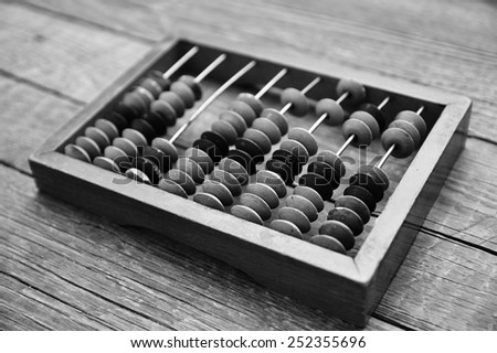 Old wooden abacus in black&white colors - stock photo