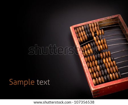 old wooden abacus on a dark background with place for text