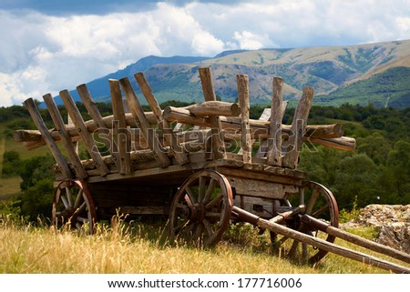 Old wooden abandoned wagon  - stock photo
