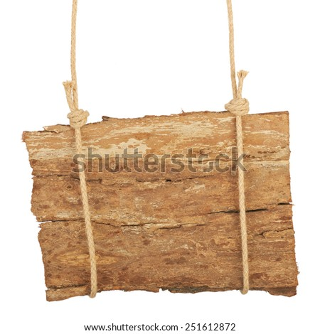 Old wooden background, a sign on the rope - stock photo