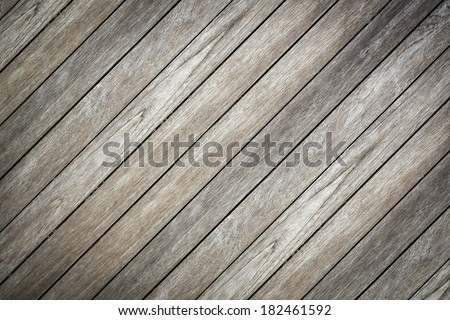 old wooden background and crosswise in garden - stock photo