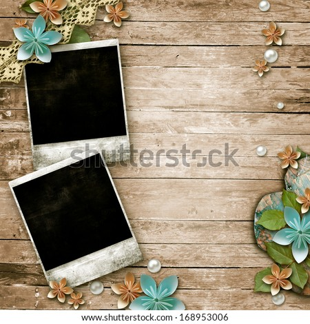 Old wooden background with a frame for photo, flowers, pearls and lace  - stock photo