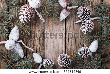 Old wooden background with pine cones fir-tree branches. Christmas decoration.Copy space. selective focus.  - stock photo