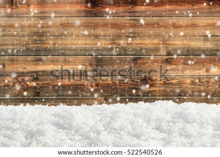 Old wooden background with snowfall and snowdrift