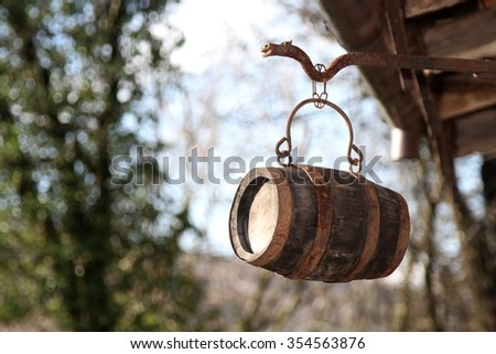 old wooden bar on a medieval sign of a tavern - stock photo