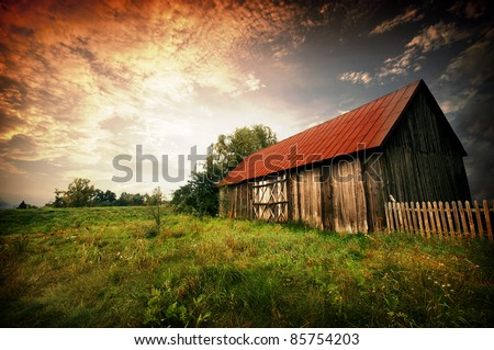 Old wooden bar with red roof over the dramatic sunset. Zalew Zegrzynski, Poland - stock photo