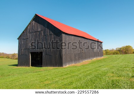 Old wooden barn at countryside - stock photo