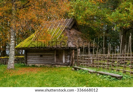 Old wooden barn in the medieval village. View of the patio of farm. The open air Museum in Tallinn. Photographed in the fall. Historical landmark of Estonia. The old medieval architecture of Estonia.