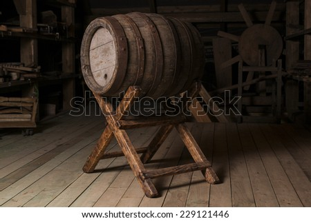 Old wooden barrel on a stand - stock photo