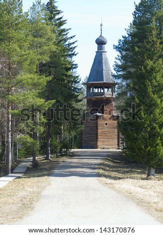 Old wooden belltower in Malye Karely (Little Karely) near Arkhangelsk, north of Russia, Europe - stock photo