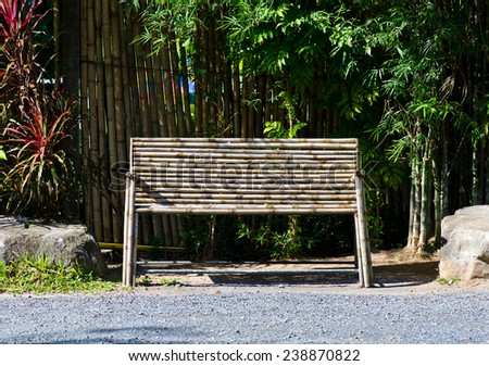 Old wooden bench in the park. - stock photo