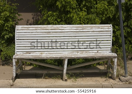 Old Wooden Bench With Peeling Paint - stock photo