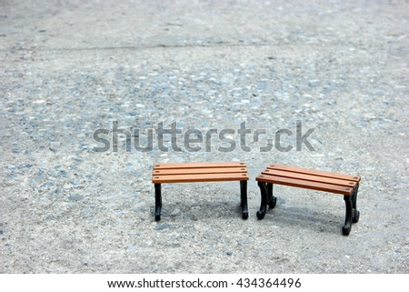 old Wooden benches model stand couple on concrete road in sunny day.