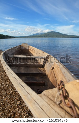 Old wooden boat - stock photo