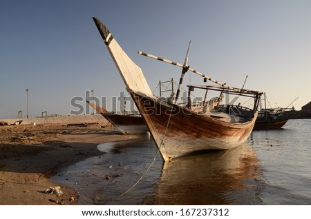 Old wooden boat (dhow) in the harbor of Sur, Sultanate of Oman, Arabia - stock photo