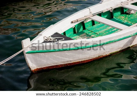 Old wooden boat moored in Montenegro - stock photo