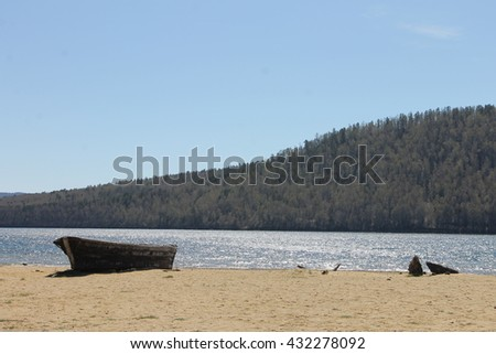 Old wooden boat on the shore of Lake Baikal.