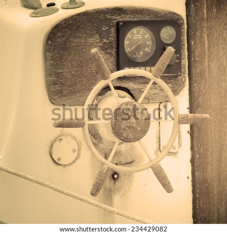 old wooden boat wheel. Processed for vintage tone effect. - stock photo