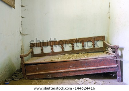 old wooden broken bed in an abandoned house - stock photo