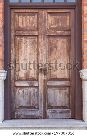 Old wooden brown house door in Hong Kong - stock photo