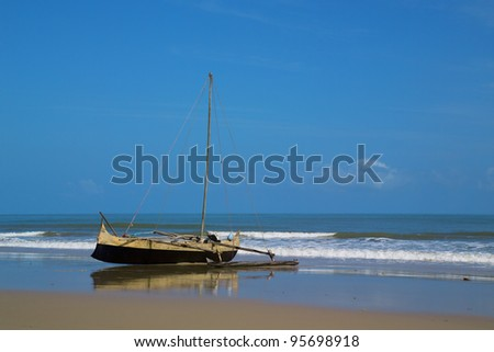 old wooden canoe on the beach madagascar