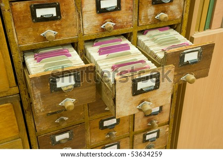 Old wooden card catalogs with open drawers - stock photo
