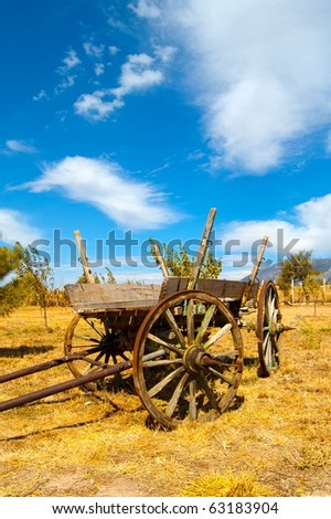 Old Wooden Cart in the Field - stock photo