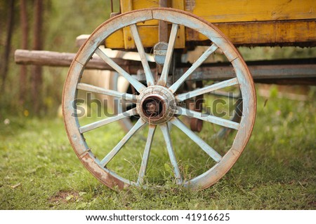 old wooden cart wheel - stock photo