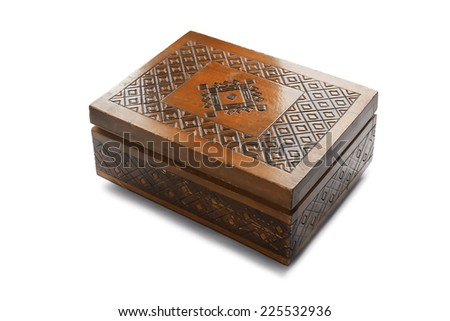 Old wooden carved closed box isolated over white - stock photo