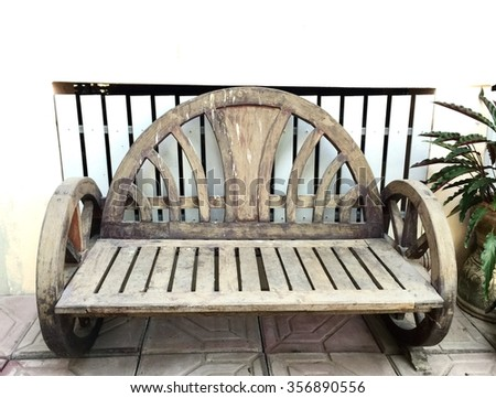 Old wooden chair with home background  - stock photo