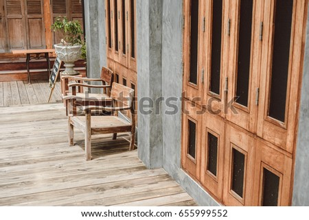old wooden chair with vintage wooden wall