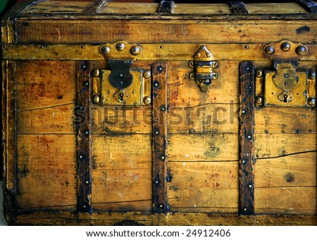 Old wooden chest, trunk in golden color and rusty - stock photo