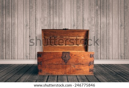 Old wooden chest with open lit - stock photo